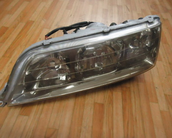 Toyota - 100-mark? Only genuine headlight / left